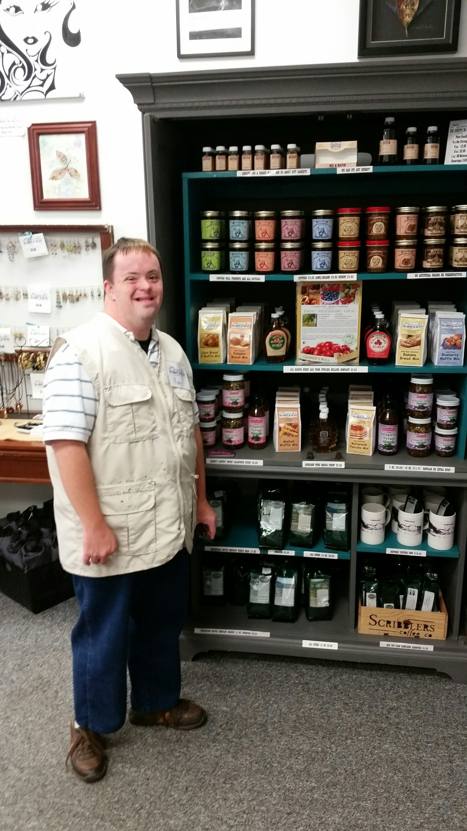 Ray standing by the Coopers display at the Shoppe