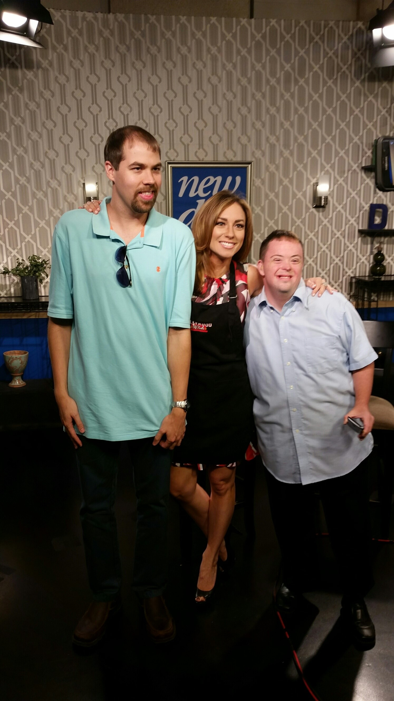 Al and Ray posing with Natalie from Good Day Cleveland