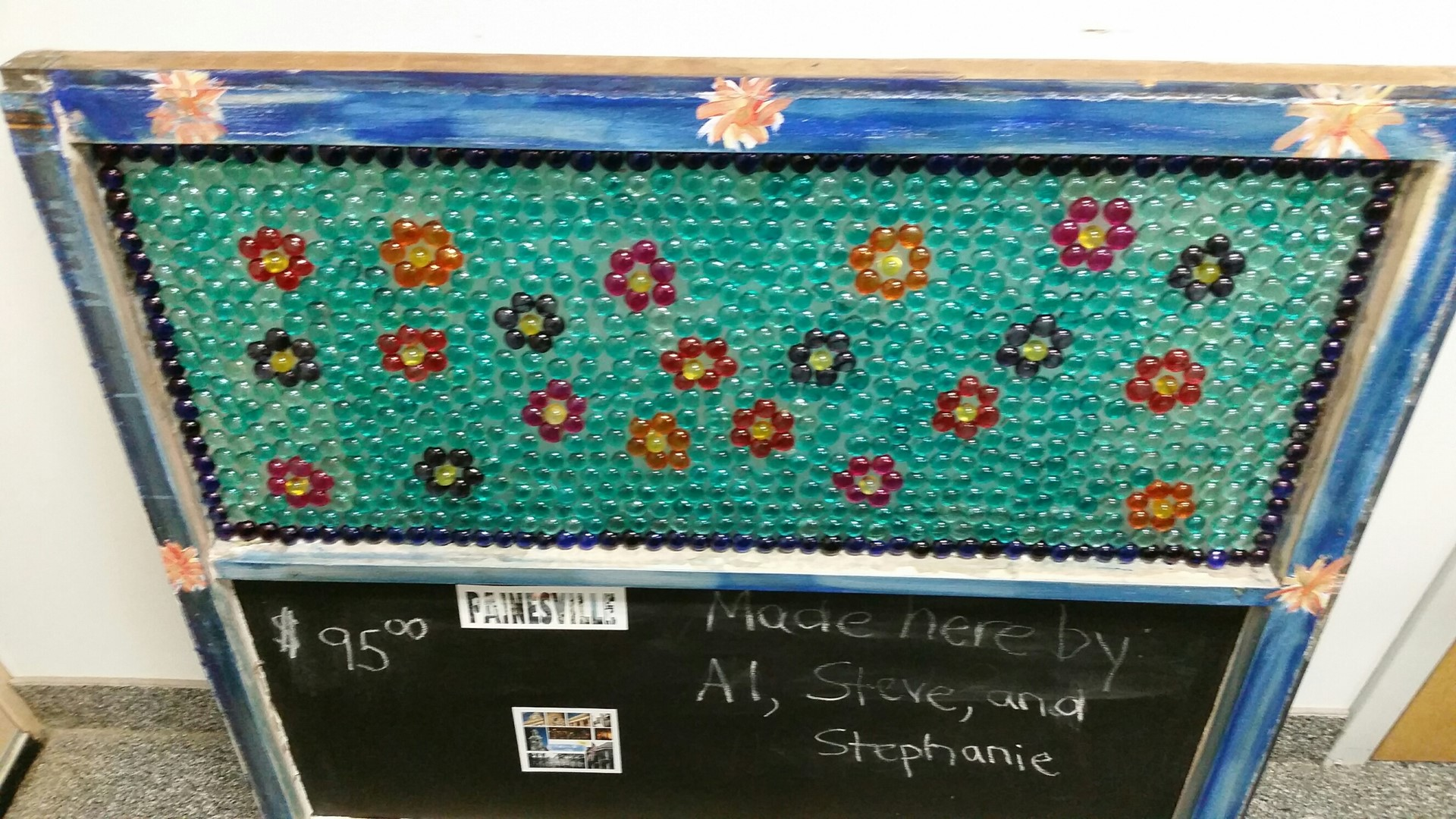 Beaded sheetmetal window with flowers and chalkboard bottom