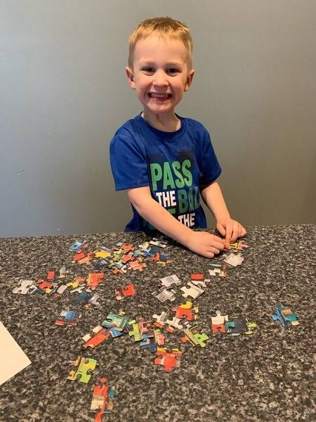 Child doing a puzzle