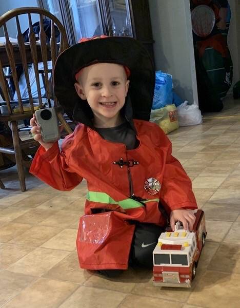 Child Dressed as a fire fighter