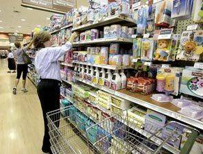 Student stocking shelves at Heinen's Grocery Store